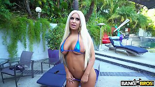 brandi bae shows off her nice big tits ans ass poolside