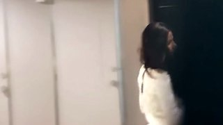Skinny white chick in black pants filmed in the toilet room