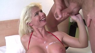 Blonde milf with silikon tits sucks her lover's big cock