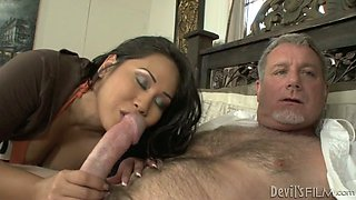 Exotic looking hotties giving double blowjob to horny old daddy