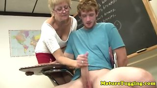 Shorthaired blonde gilf teacher strokes his hard cock