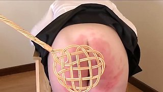 Schoolgirl punished with the carpetbeater