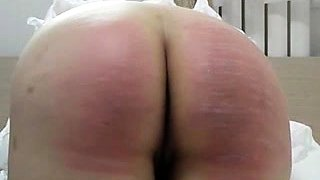 Amateur girl bends over and gets her lovely ass spanked hard