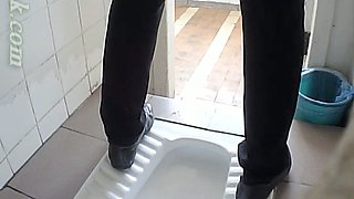 White amateur chick in black pants pissing in the toilet