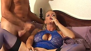 Big tits blonde smoking