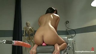 horny brunette has an amazing orgasm with a fucking machine