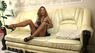 This minx is elegantly hot and the pantyhose makes her legs look sexy
