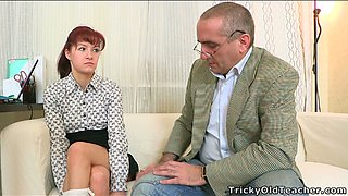 Redhead chick in college uniform sucks hard cock of the older man in the office