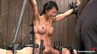 Extreme bondage with Asian Tia Ling getting toyed