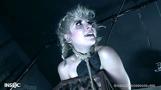 Pretty teen blonde slave Dolly Mattel tied up and spanked in a dungeon