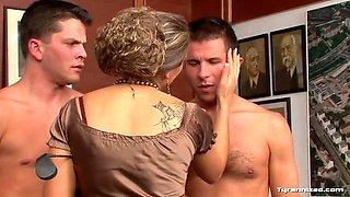 hrny dominatrix punishes two slaves
