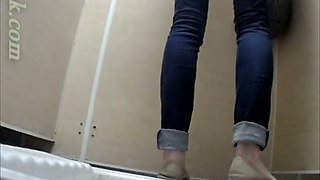 Pale skin slim white teen babe in jeans pisses in the toilet