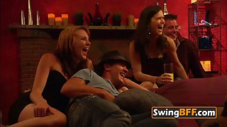 Eager swinger couple is excited about having a blast at swinger party