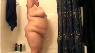 I expose my admirable big belly when I take shower