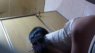 Two asian women spied in public toilet pissing