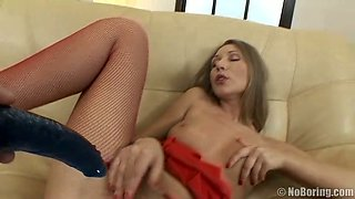 Drunk fair haired chick in red fishnets gets her pussy fucked with black dildo