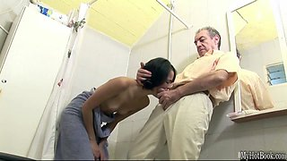Sexy brunette is about to hop in the shower when an older guy