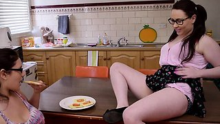 Curvy lesbian hotties fuck in the kitchen