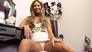 Leggy babe Natalia Forrest spreads legs and shows her yummy pussy upskirt