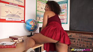 Tempting college mate Kayla Louise shows off her charming upskirt pussy