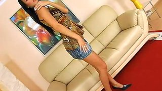 Lusty dark-haired bitch with nice tits takes her muff to a cute toy insertion