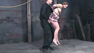 Sexy babe with plump tits is tied up and suspended before face fuck