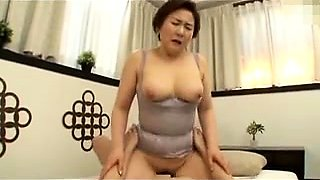 Big breasted Japanese granny has a passion for hardcore sex