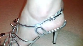 Sexy close-up of pretty feet in heels