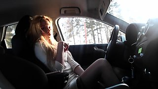 Elegant blonde beauty fucks herself with sex toys in the car