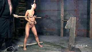 Sex-slave Tia gets her pussy punished with vibrator in the dungeon
