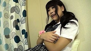 Pigtailed Asian schoolgirl with a sweet ass loves hard meat