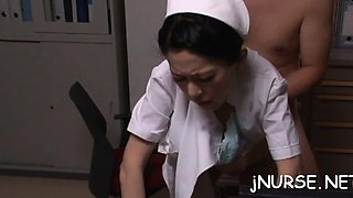 Nurse takes a large dick in her throat and sucks it hard
