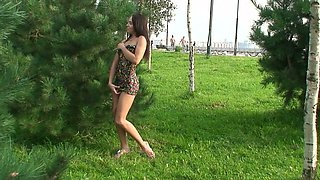 Fabulous redhead Russian college girl flashes her goodies behind the tree