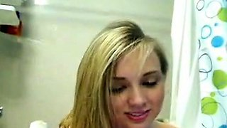 Blonde teen gets naked in the bath