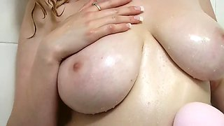 Blondie with huge tits takes a sensual shower