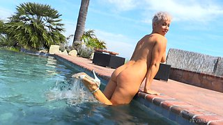 Ryan strips by the pool and exposes her shaved MILF pussy in public