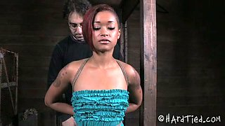Seductive ebony gal with plug in her mouth hole gets punished