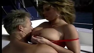 Pretty woman with big tits fucks an old man on his yacht