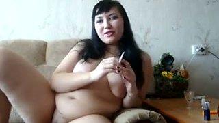 Big breasted coed just loves masturbating on webcam