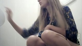 Long haired hot blonde girl pisses in the toilet room