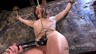 A kinky slave babe is being roughly abused