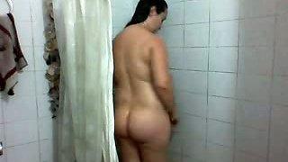 Plump big bottomed amateur Indian all nude brunette takes a shower