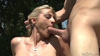 Nasty blonde milf Sindy Lange has sex with a guy near a pool