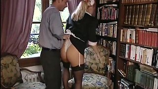 A very sexy blonde Brit Laura  has a pair of dicks that she is sucking on like a winner