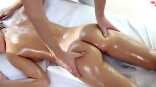 Oiled Up Blonde Beauty Getting Fingered On Massage Table