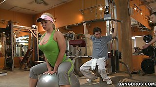 Busty milf rides a stud's large cock in the gym