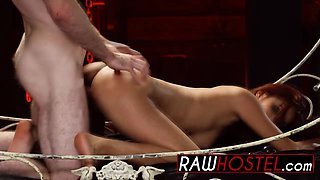 A cute babe gets roughly fucked and abused by a muscled stud with a monster cock