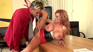 sexy milf is fucked as she bends over the living room table