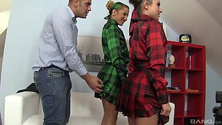 Two curvy girls in colorful clothes having a stunning threesome