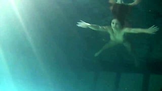 Hot fresh gingerhead teen in the dark pool shows her pussy